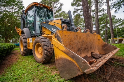The Garden Of Oz How To Use A Backhoe For Excavating Your